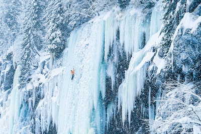 Kyle-Meyr-Sony-alpha-9-mountain-climber-ascending-icy-cliff-face