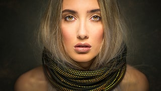 terry-donnelly-sony-alpha-7RIII-close-up-portrait-of-lady-wearing-a-black-and-yellow-chain-collar