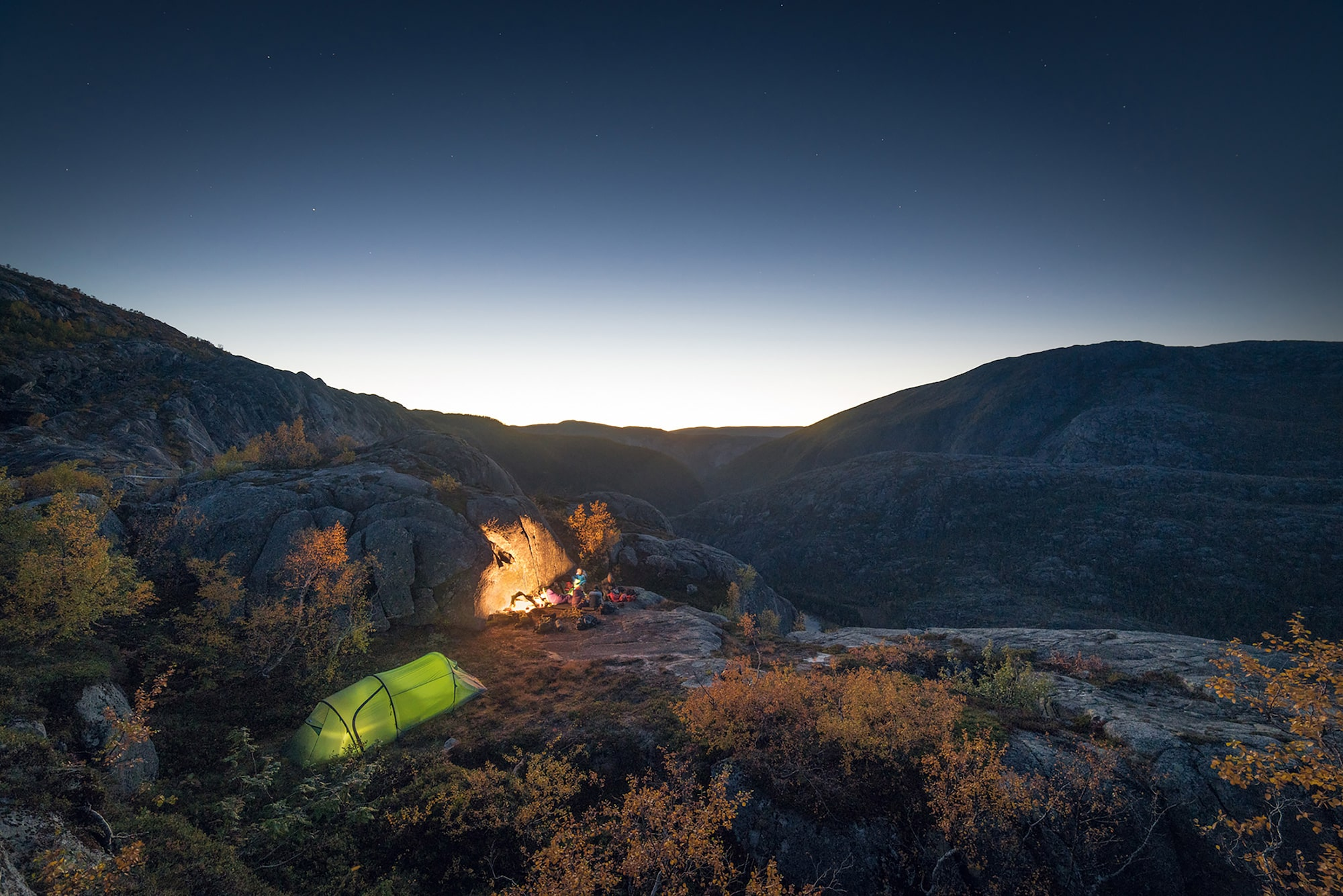 Kyle-Meyr-Sony-alpha-99II-group-of-climbers-camping-on-a-mountain-illuminated-by-late-evening-sun